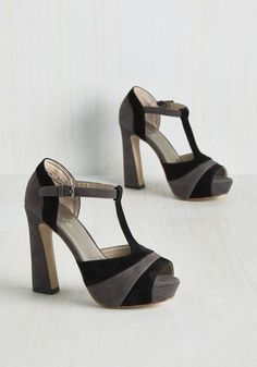 In the rare moments you won't be sporting these colorblock heels, you'll certainly be dreaming about them! Indulgent to the imagination with their funky angular pumps and velvety layers black and soft grey hues, these T-strap peep toes always have a special place in your mind - and your wardrobe!