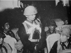 japanese army instructor talking with taiwanese soldiers of the Takasago Volunteers before a mission against allied forces in the phillipines (oct 1944)  Officers wore the white criss cross seen above, NCO's wore a single white stripe and ordinary soldiers wore white armbands so that they could be seen... Pin it by GUSTAVO BUESO-JACQUIER