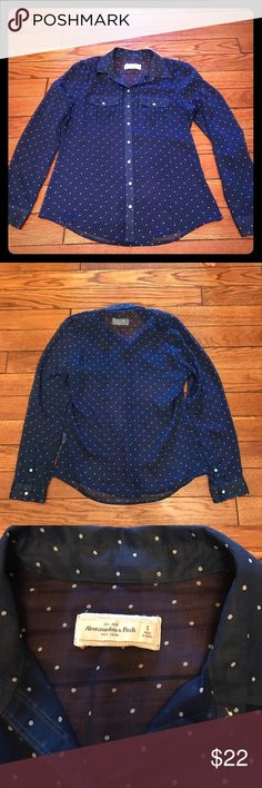 Abercrombie Navy and White Polka Dot Sheer Top Abercrombie Navy and White Polka Dot Sheer Top.  Looks great with white jeans!  Approximately 40 inch bust and 26 inches long from the shoulder seam.  Fabric care tag is missing. Abercrombie & Fitch Tops Button Down Shirts
