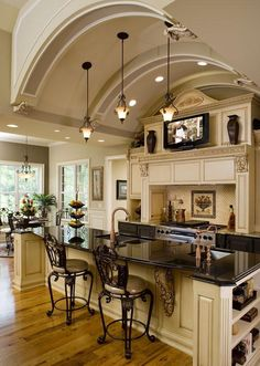 I like this lay out with the tv and all but do not like the bar stools.Love the arch in the ceiling.