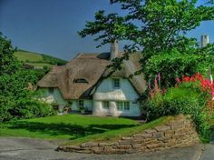 CURB APPEAL – another great example of beautiful design. english storybook cottage a thatched roof is charming. Fairytale Cottage, Garden Cottage, Cozy Cottage, Cottage Homes, Cottage Style, Irish Cottage, White Cottage, Tudor Cottage, Cottage Bedrooms