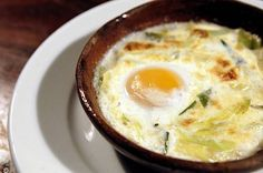 Wood oven-baked egg with herbs and cream served at Camino restaurant in Oakland, Chron 100 2013