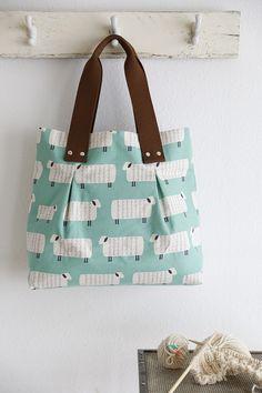 with kokka fabric http://www.modes4u.com/en/kawaii/p24934_mint-green-Sheep-animal-sheep-Canvas-fabric-Charms-Kokka.html