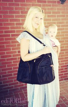 Tori Spelling with her daughter Hattie and her fave diaper bag from Skip Hop - love that diaper bag!