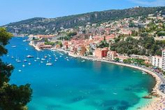 The 10 Best Beaches in the South of France. Picture of a harbor and beach in Villefranche-sur-Mer in the South of France
