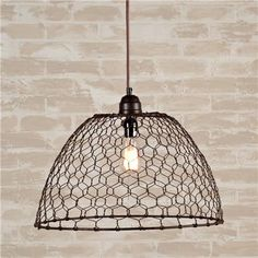 "Cagey Lighting - With industrial trends, steampunk and rustic influences... and budgets in mind - check out these ""chandeliers"" - Love Em    Chicken Wire Basket Pendant Light"