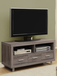 Like the size, the look, and the color, but particle board? Reclaimed-Look 3-Drawer TV Console on Gilt