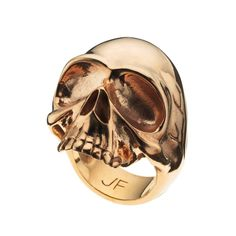 this skull ring compliments a grunge flannel and combat boots type outfit.