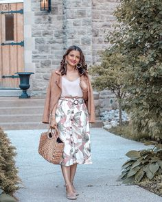Tropical Prints and Pearl Hoops with Le Chateau Le Chateau Tobacco Suede Aviator Moto Jacket Tropical Print Skirt Structured Straw Bag Espadrille Wedge Sandals and Pearl Hoops Blogger Outfit