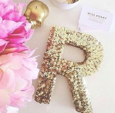 Wooden letter with sequins