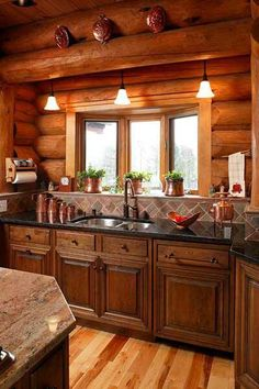 These cupboards go great in the log home.  Backsplash too.