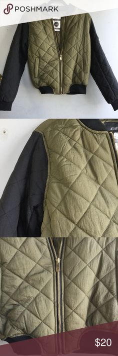 Olive Quilted Bomber Jacket How adorable is this two tone quilted bomber jacket! It's double layered but has great movement. Perfect to wear with just about anything! shell 1 100% nylon shell 2 %100 polyester. Fits true to size. Jackets & Coats