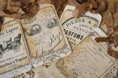Vintage paperie tags (set of 4) with crinkle ribbon and german glass glitter. $4.25 from countingyourblessings