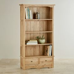 The Cairo Natural Solid Oak Tall Bookcase features the understated, timeless design at the core of the Cairo collection.