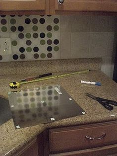 $13 upgrade - placemat backsplash idea for the kitchen in our rental