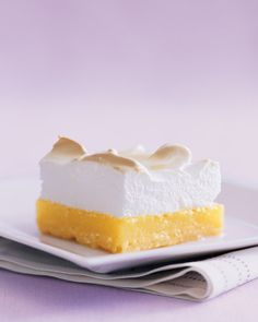 It's as easy as pie to make bars from smooth, tangy lemon filling and fluffy meringue atop a buttery zest-flecked crust.  Martha Stewart Living, July Summer 2005