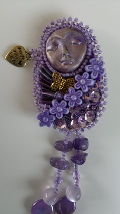 Beaded Art Doll Brooch with amethyst.