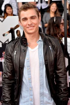Dave Franco pairs a light washed denim shirt with a bomber jacket for the 2014 MTV Movie Awards