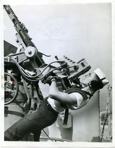 US sailor manning an anti-aircraft gun, 1943.