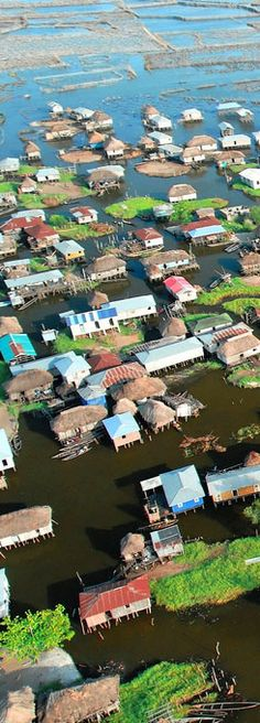 The lake village of Ganvie, in Benin. #Africa.  At first I thought this was a picture of a flood, then I saw that the houses were made to sit above the water!
