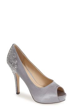 Free shipping and returns on Menbur 'Sanco' Peep Toe Pump (Women) at Nordstrom.com. A flourish of crystals puts an eye-catching finish on this lustrous silk-satin pump. The peep-toe silhouette shows off your pedicure to perfection, while the partially covered platform creates a comfortable pitch that will last from the red carpet through the after party.