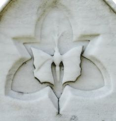 Butterfly Headstone - The butterfly's life cycle is a symbol of the Victorian hope for their own life cycle:  life as a lowly caterpillar, death in a cocoon, and resurrection as a butterfly soaring to heaven.