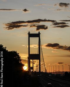 Photos of the sun setting behind the towers of the 1st Severn Bridge crossing the Severn Estuary into #Wales http://www.paulfearsphoto.co.uk/index.php?cat=photographs&id=16&album=Photographs%20of%20Bridges&sub_album=Severn-Bridge-at-Sunset