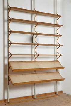 Shelving system, designed by Bruno Mathsson for Karl Mathsson, Sweden. Lacquered steel, birch and pine.