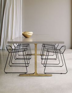 Dining table with brass legs