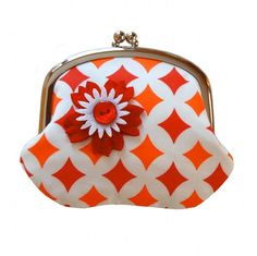 This coin purse is super cute ... and super handy! What an adorable way to stash your cash! The pouch has a white background with geometric print in