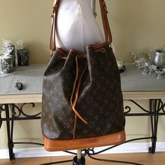 ✨AUTHENTIC LOUIS VUITTON NOE'✨ This is an old bag but she is still in great condition.  Some minor stains from normal wear.  The strap is in great condition.  Date code is AR0063.  Ask for additional pictures if needed. This is an old bag there is no receipt or box.  This was purchased at the Millenia Mall in Orlando, Fl. TRADES PAYPALLOWBALL Louis Vuitton Bags Shoulder Bags