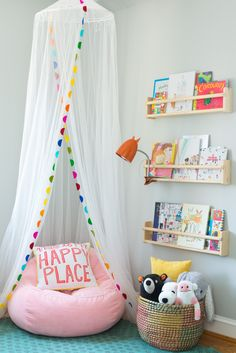 kid reading nook with book ledges, girl bedroom decor with canopy and reading corner, playroom decor for girls bedroom ideas toddler Toddler's Whimsical Bedroom Makeover