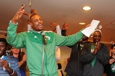 Paul Pierce of the Boston Celtics sings holiday songs with patients at Boston Children's Hospital.