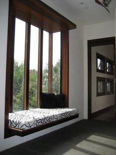 Not a fan of the black and white, but LOOOVE the actual window - with a different cushion this window seat would be amazing.