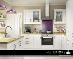 Fun and bright white shaker kitchen. Oak worktops mixed with purple accent in the glass splashback