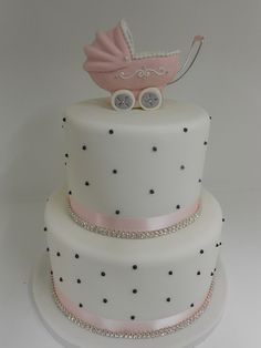 #1 LOVE THIS! Soft pink ribbon, white fondant, and black detailing...maybe baby booties or an 'E' on top!?!? *chocolate, vanilla, amaretto, red velvet