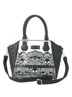 Bag with a black and white filigree skull pattern. Interior includes zip pocket and cell phone and stash pouches.
