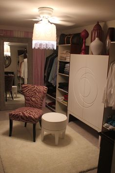 Turning a spare room into a walk-in closet.  Purchased some inexpensive closets from Ikea. (3 wardrobes for fifty dollars each)  Purple zebra chair was purchased at Home Goods on clearance for fifty dollars (probably because it was purple) but buy purple and lavender color accents to make the room work.