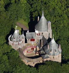 Looking down on Castell Coch (Red Castle), a Gothic Revival castle situated on a steep hillside high above the village of Tongwynlais, to the north of Cardiff in Wales Chateau Medieval, Medieval Castle, Castle Ruins, Castle House, Beautiful Castles, Beautiful Buildings, Chateau Moyen Age, Welsh Castles, Templer