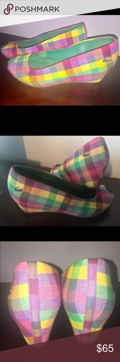 Lacoste Peep Toe Wedges These multi colored wedges are very beautiful. In awesome condition. Only flaw is inside sole being dirty which cannot be seen and can be cleaned because of the material on the inside...outside is perfect. 2' Wedge....the colors are stunning together...yellow, green, pink, and purple...material is almost like denim. They can be worn the rest of the summer and can also bring in Spring 2018. You won't be disappointed! Lacoste Shoes Wedges