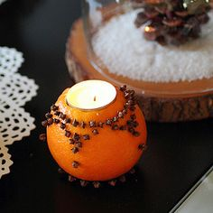 This is a cool idea. Cloves , tealight set in the Orange . I'll bet it smells so good !