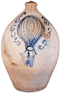 An Exceptional Cobalt Blue Slip Decorated Ovoid Stoneware Jug with a Balloon Ascension Motif   circa 1835–55. The unique subject may commemorate the historically significant 350-mile flight of Richard Clayton who ascended from the Cincinnati, Ohio Amphitheater in April 1835 and landed 9-1/2 hours later in Monroe County, Virginia breaking the world record for the farthest distance traveled in a balloon.
