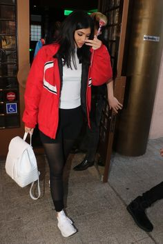 Kylie Jenner wearing  Adidas Tubular Defiant Shoes in Core White, Supreme Champion X Puffy Jacket, Alo Yoga Mesh Goddess Leggings, Nancy Gonzalez Crocodile Large Backpack