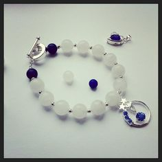 Beautiful white jade and lapis lazuli gemstone beaded bracelet with elegant toggle clasp and shooting star rhinestone charm. Gemstone Bracelets, Gemstone Beads, Lapis Lazuli Bracelet, White Jade, Jade Beads, Shooting Stars, Gemstones, Crystals, Den