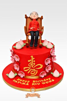 "Birthday cake for a chinese grandma with cherry blossoms and chinese peaches. The character is ""Shou"" which symbolizes longevity.   www.facebook.com/thesweeteryph  ❤️Diana"