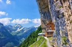 High in the Swiss alps, this is a mountain hut called Ebenalp. They say you should set your watch back ten years when you enter this region, known as Appenzell. Quaint and rustic, the old hut is built into a cliff at about 5,000 feet just below a mountain peak.  Today, Ebenalp welcomes touring hikers. It offers cheap dorm beds and hot, hearty plates of Rösti — Switzerland's addictive cheesy hashbrowns. I't s run by an elderly couple and their five children and the guest book goes back to…
