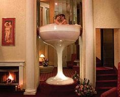 Another one of me and Jordans honeymoon locations.. Caesars hotel at the pocono mountains rooms are two story I believe with this wine glass hot tub in your room and heart shaped jacuzzis too