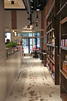 Floors- shelves- ladder- vicino pastaria & deli | scout magazine, via Flickr