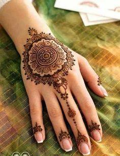 Round mehendi design is in fashion since years now   Mehndi Design