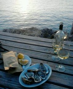 White sparkling wine beside the sea at sunset